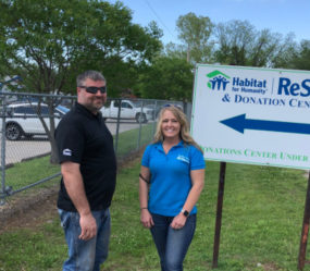 FWC Project Manager Kevin Harvey And ReStore Manager Jennifer Muret Pose For A Photo After FWC's Donation.